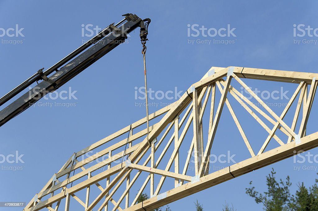 Crane Lifing House Truss royalty-free stock photo