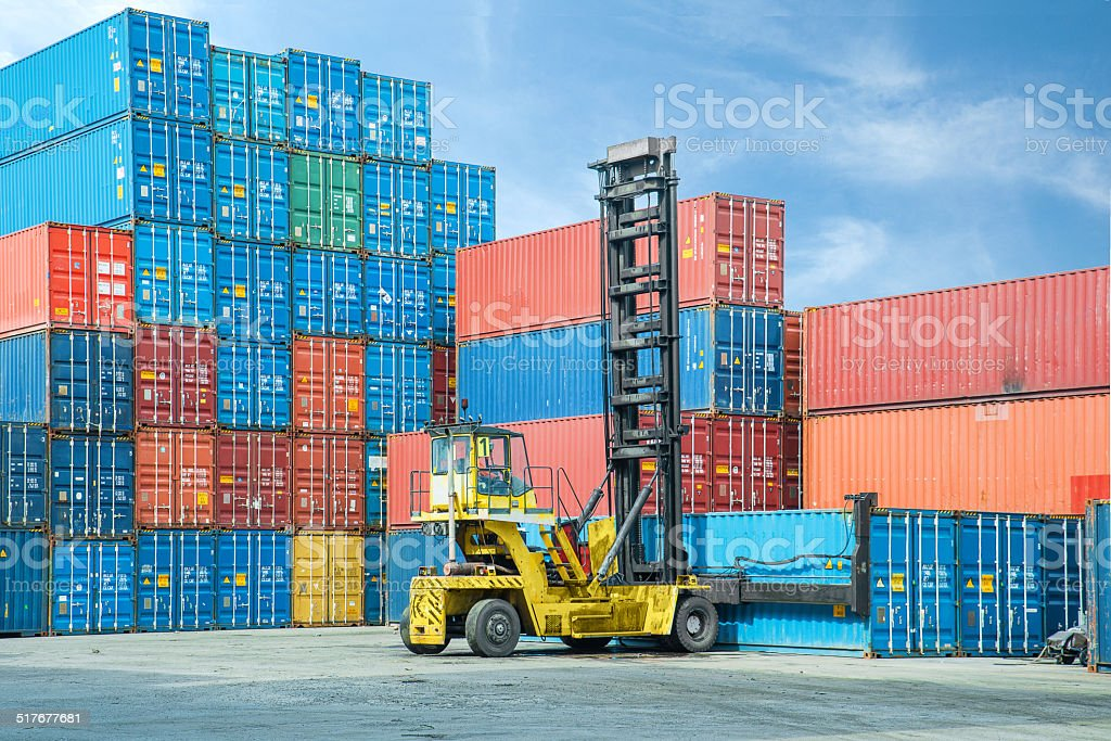 Crane lifter handling container box loading to depot stock photo