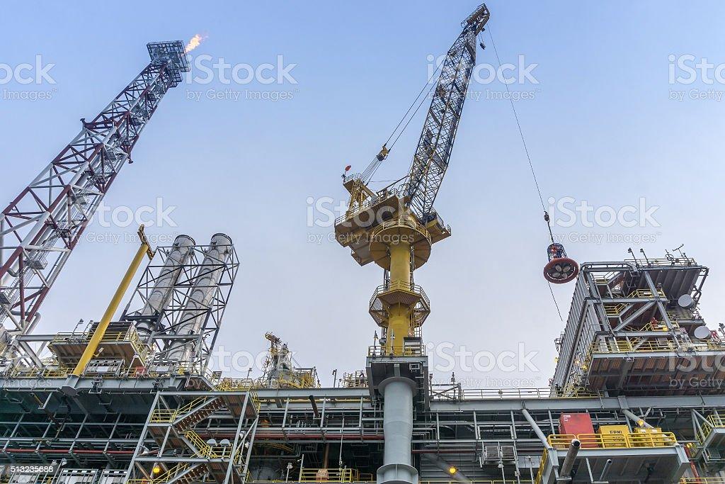 Crane lifting personal basket transfer stock photo