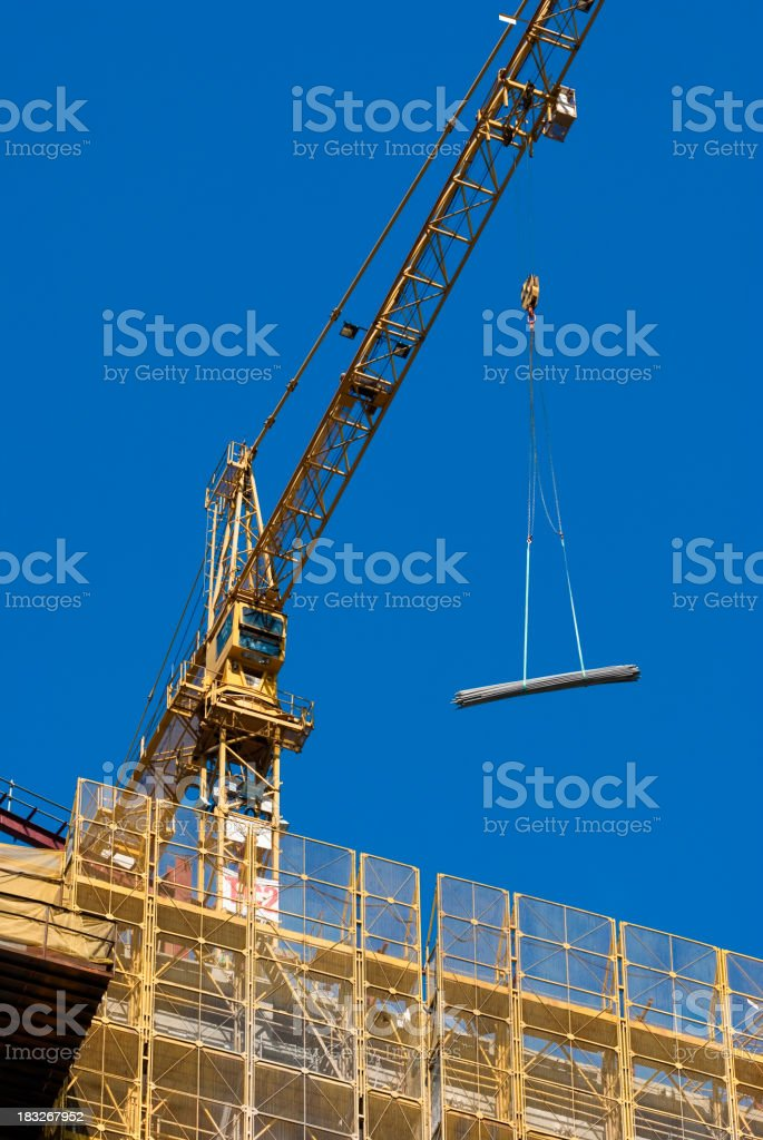 Crane lifting royalty-free stock photo