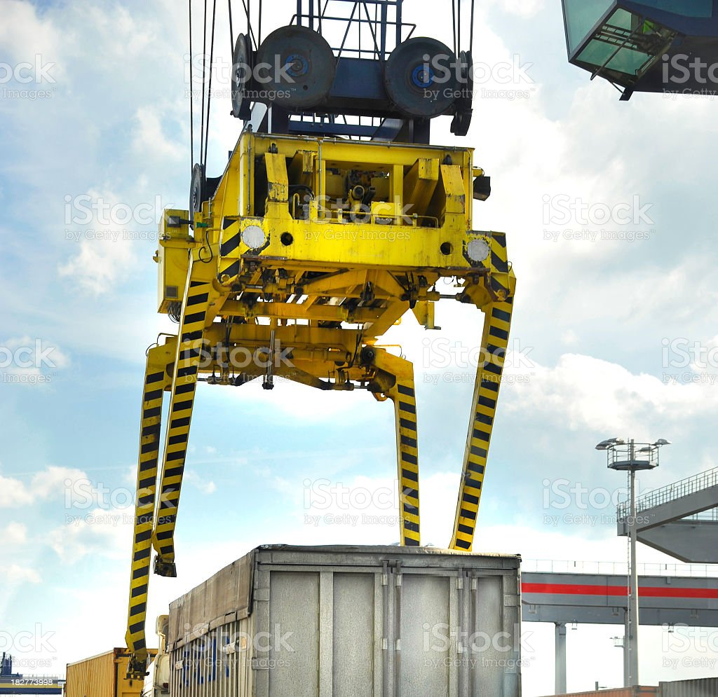 crane lifts heavy cargo container royalty-free stock photo