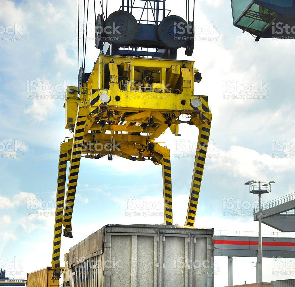 crane lifts heavy cargo container stock photo