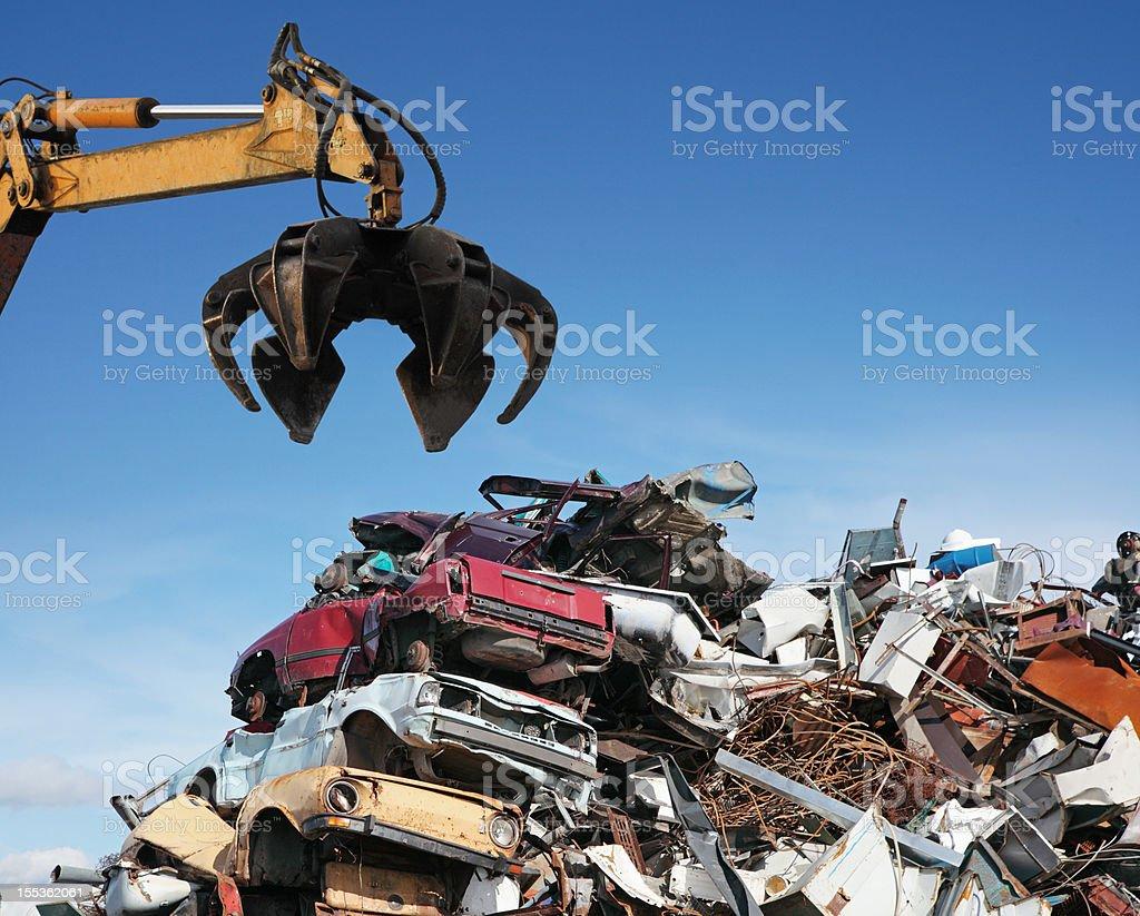 Crane loader taking scrap iron stock photo