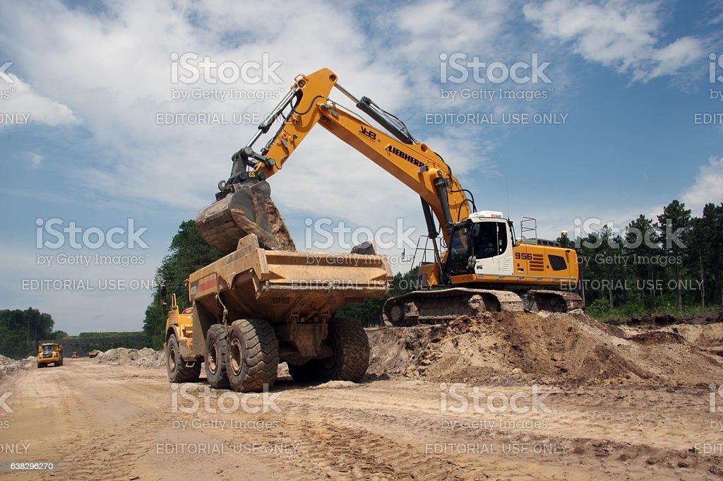 Crane loading a dumper stock photo