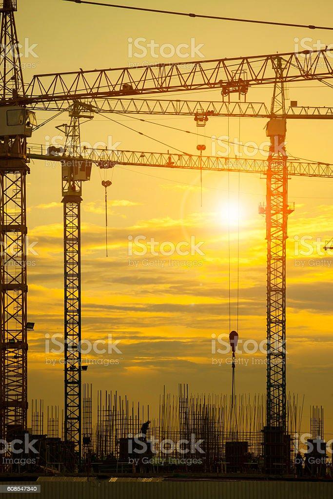 crane of building construction against beautiful dusky sky stock photo