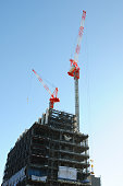 Crane of construction site against clear sky with copy space
