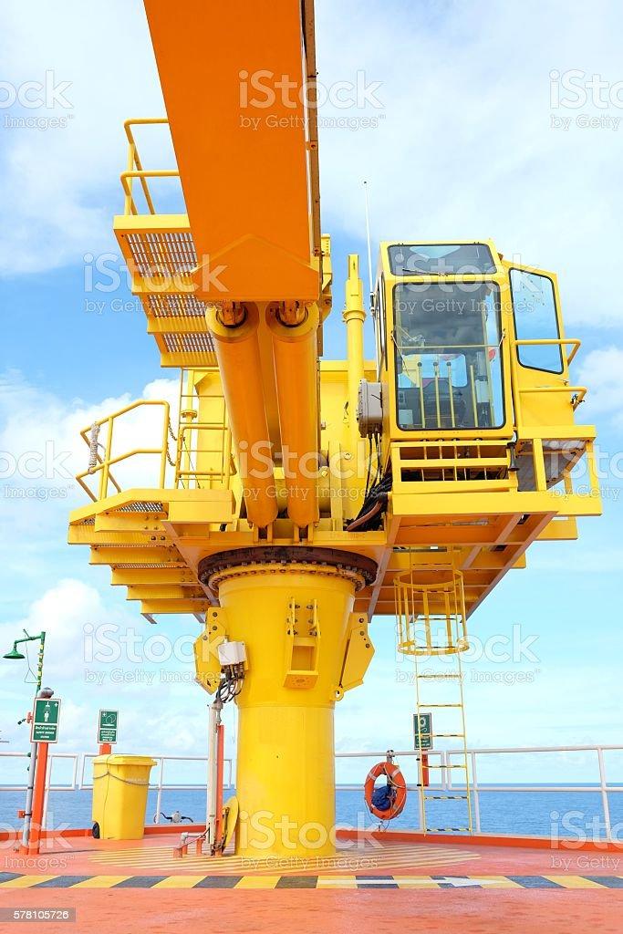 crane offshore wellhead remote platform stock photo