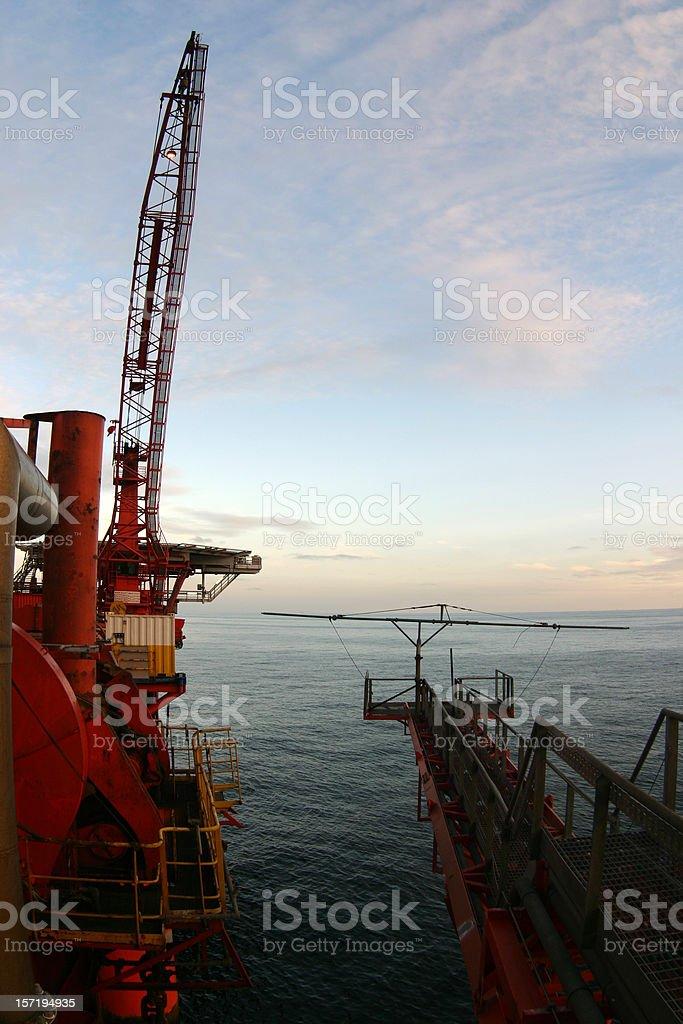 Crane on oil rig platform royalty-free stock photo