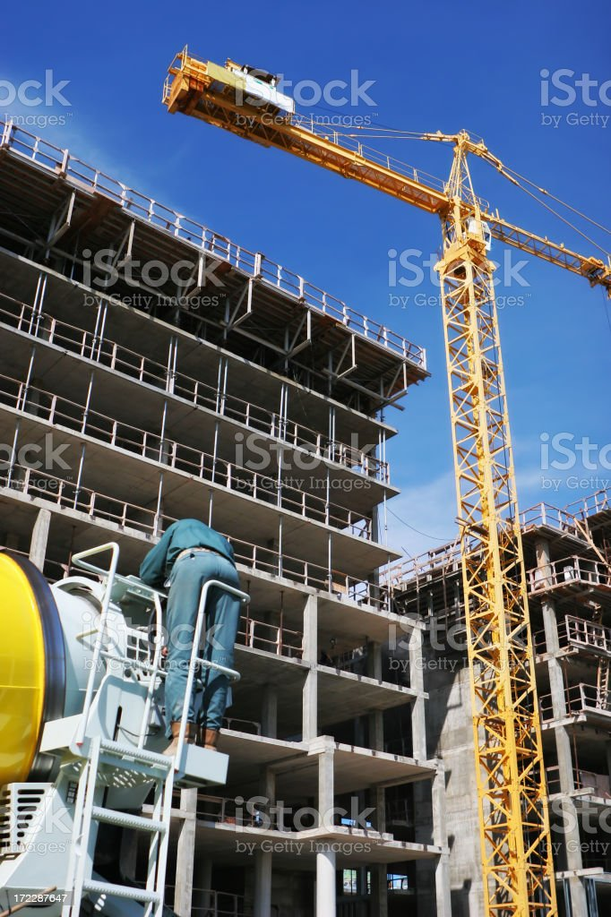 Crane over a Highrise Construction Building royalty-free stock photo