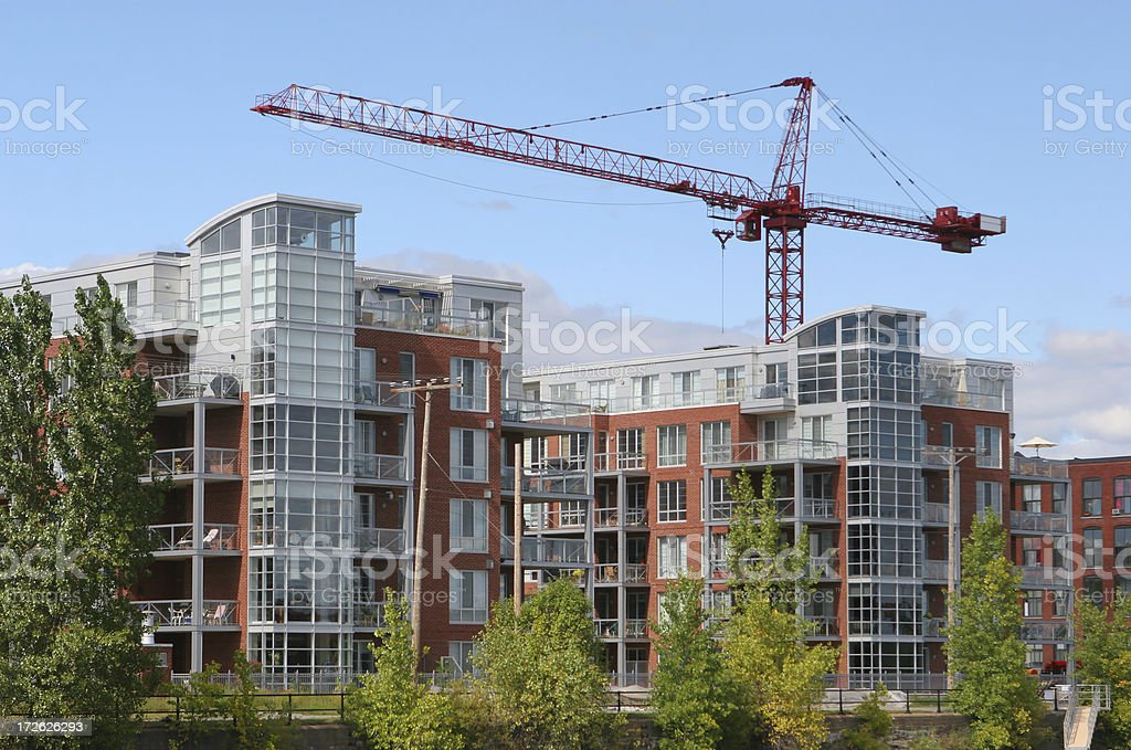 Crane over a Modern Residential Construction royalty-free stock photo