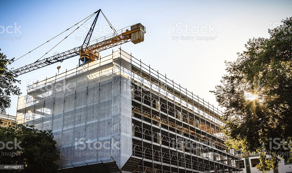 Crane over Commercial and Residential Building stock photo