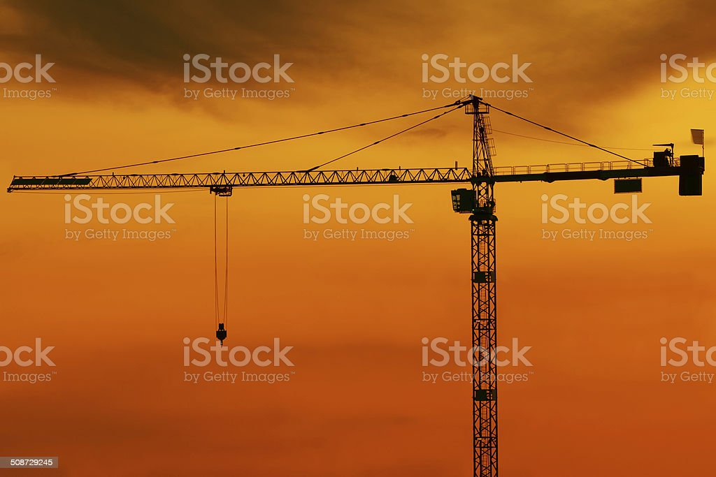 crane silhouette at dusk royalty-free stock photo
