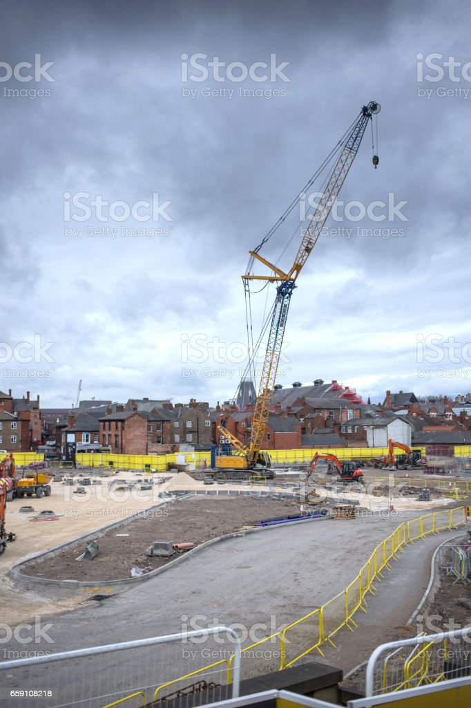Crane standing over a construction site in Lincoln stock photo