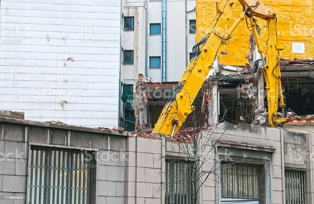 Crane tearing down attached building in Barcelona royalty-free stock photo