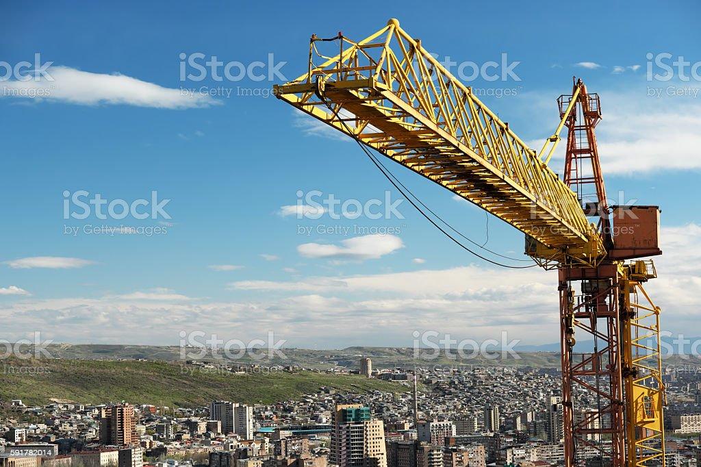 Crane tower against a blue sky stock photo