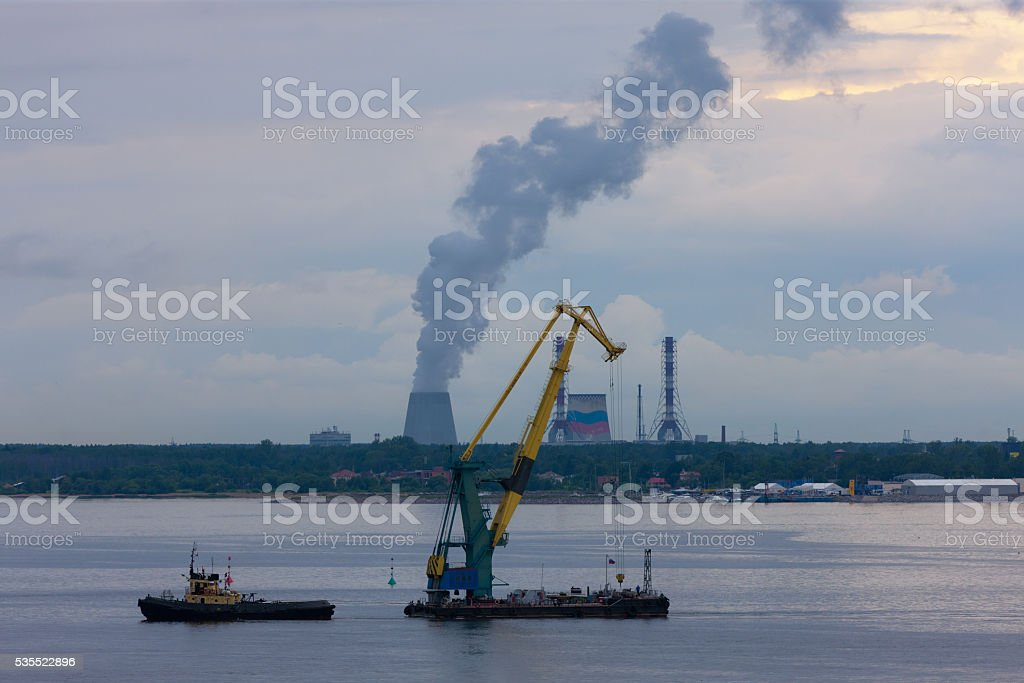 Crane transportation on a tow across gulf of Finland, Sankt-Peterburg.