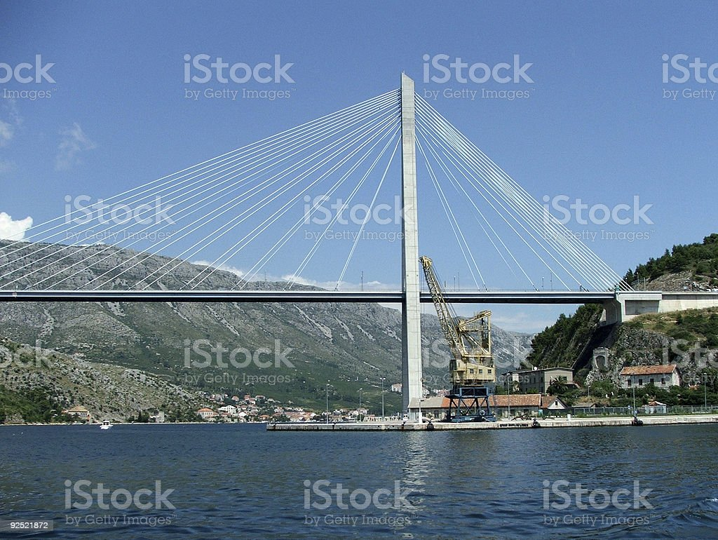 Crane Under Suspension Bridge - Dubrovnik, Croatia royalty-free stock photo
