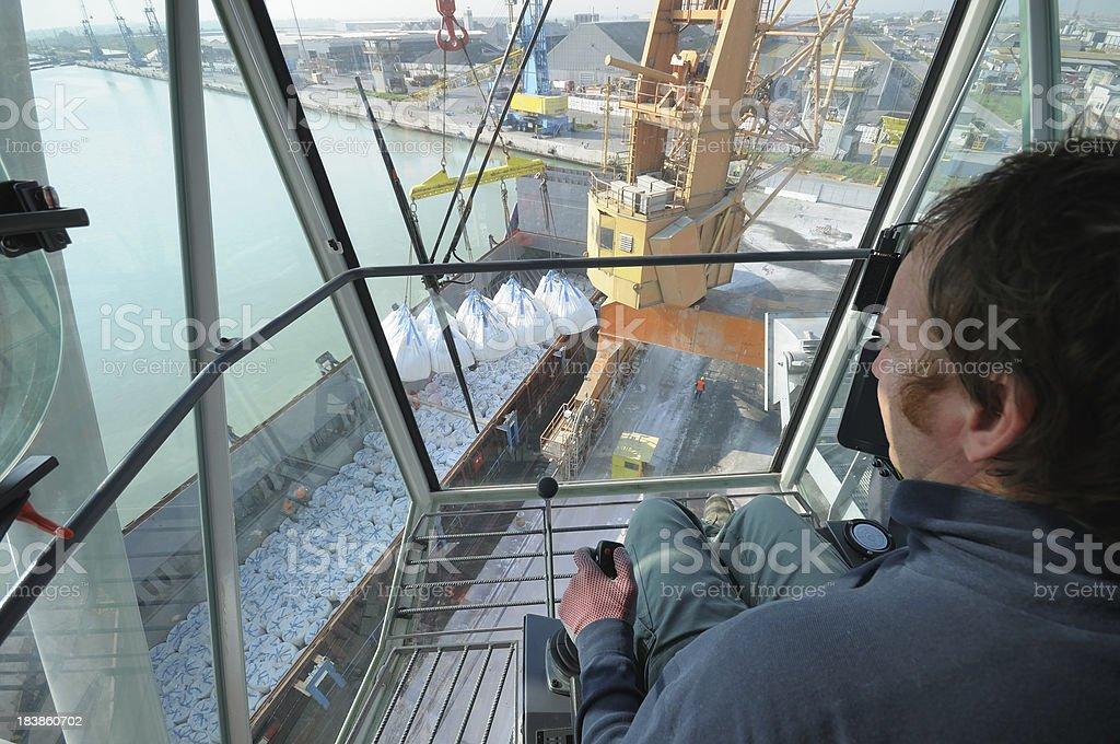Crane unloading cargo stock photo