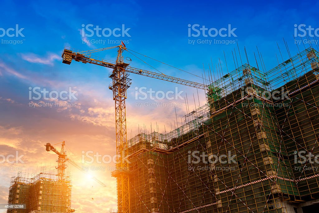 A crane working at a construction site stock photo
