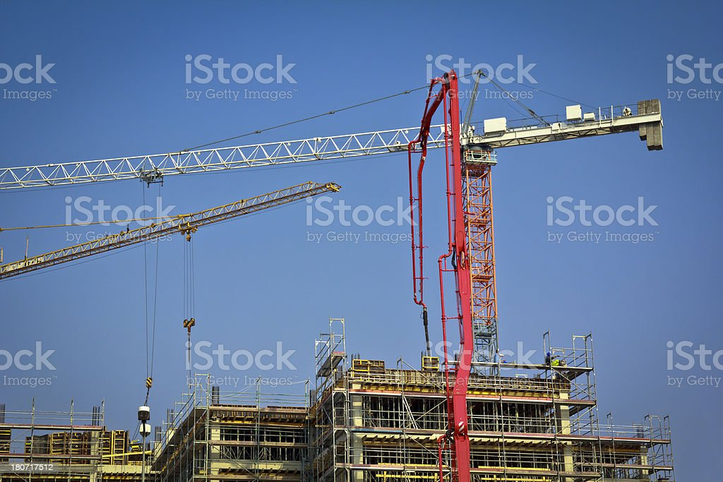 Cranes against blue sky royalty-free stock photo