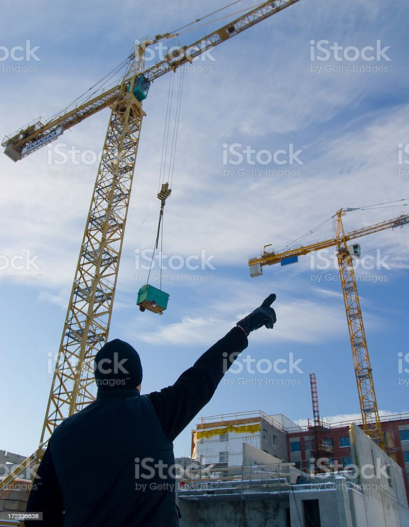 cranes and builder royalty-free stock photo