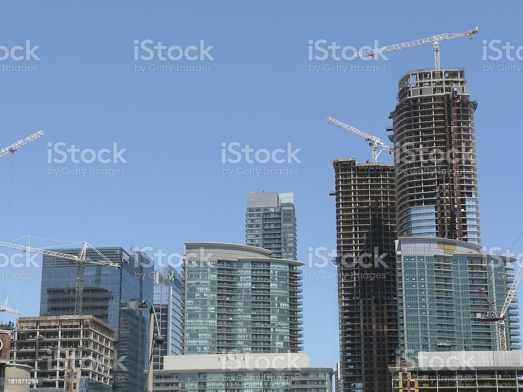 Cranes and condomium construction royalty-free stock photo