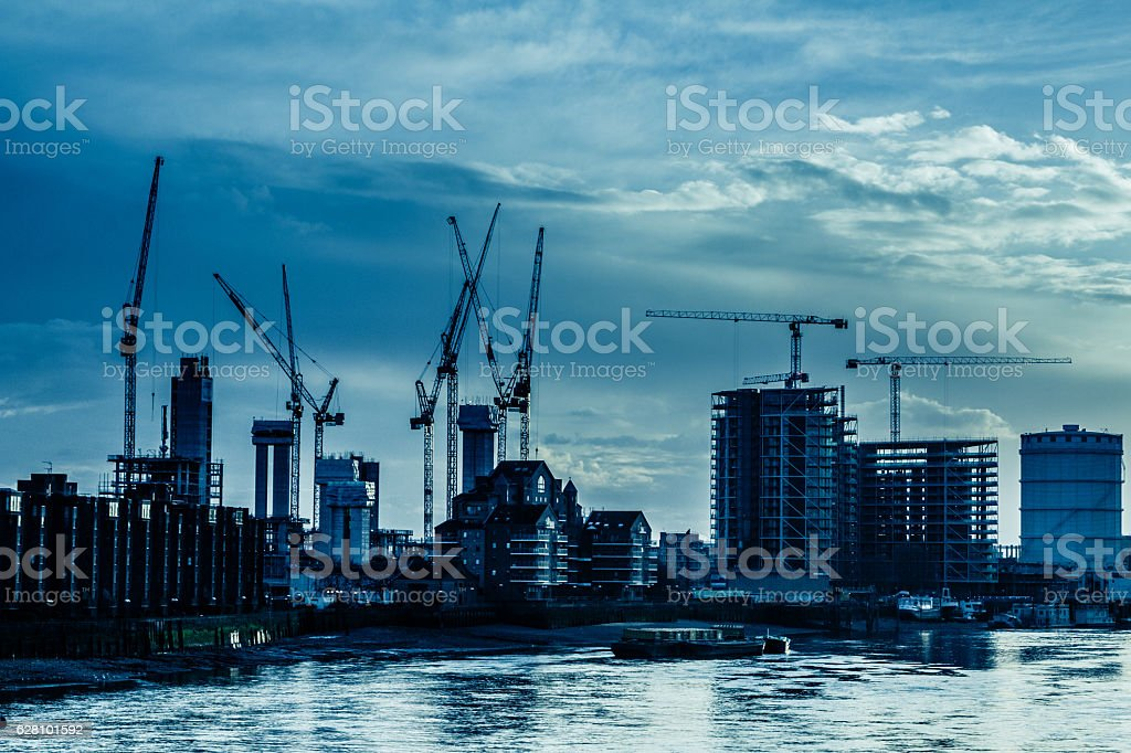 Cranes and Construction by the Thames on London Skyline stock photo