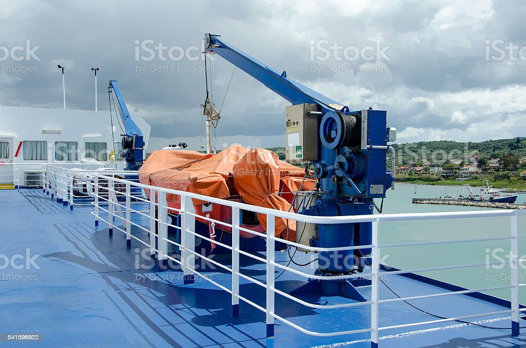 Cranes and life boats on ferry boat stock photo