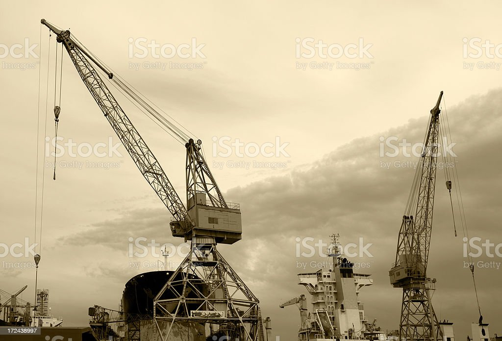 Cranes and ship in a harbor royalty-free stock photo