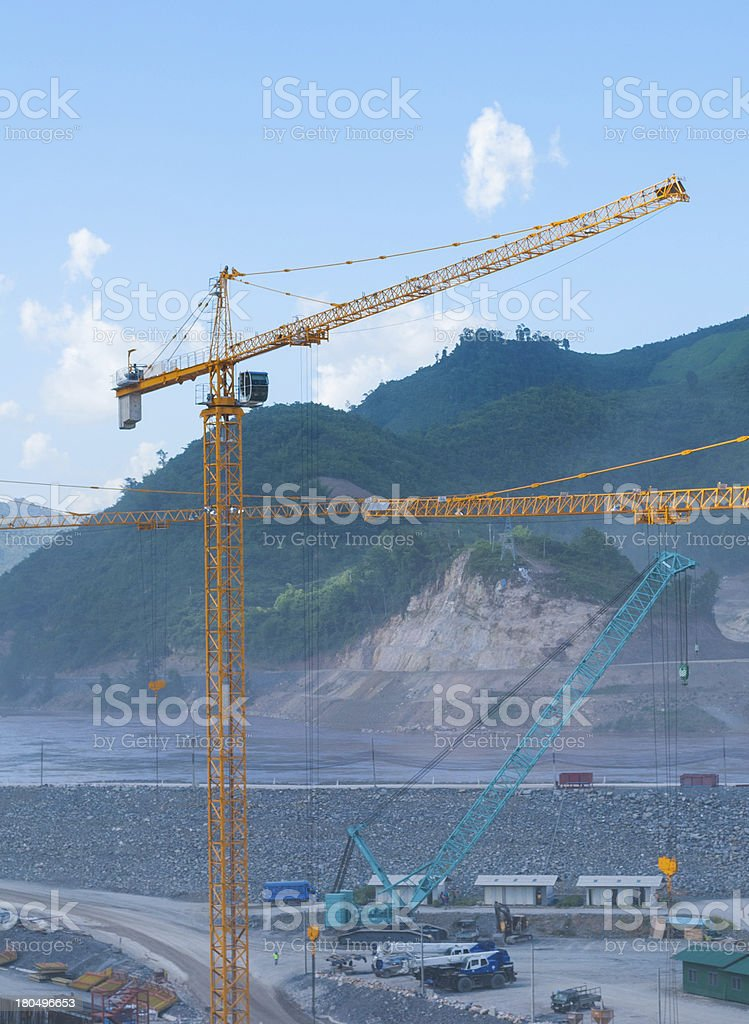 cranes at a construction site in mountain area royalty-free stock photo