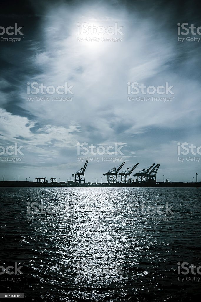 Cranes at a Port Silhouette royalty-free stock photo