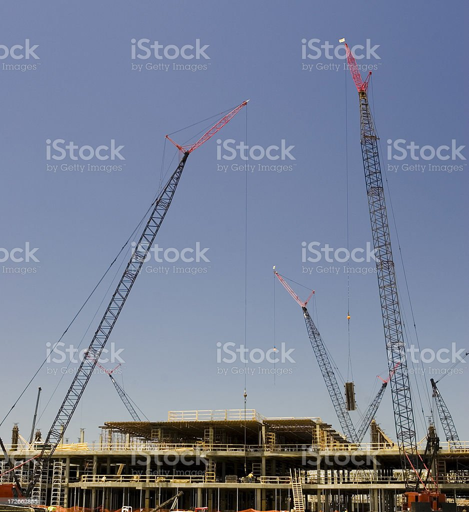 Cranes at Factory Construction Site royalty-free stock photo