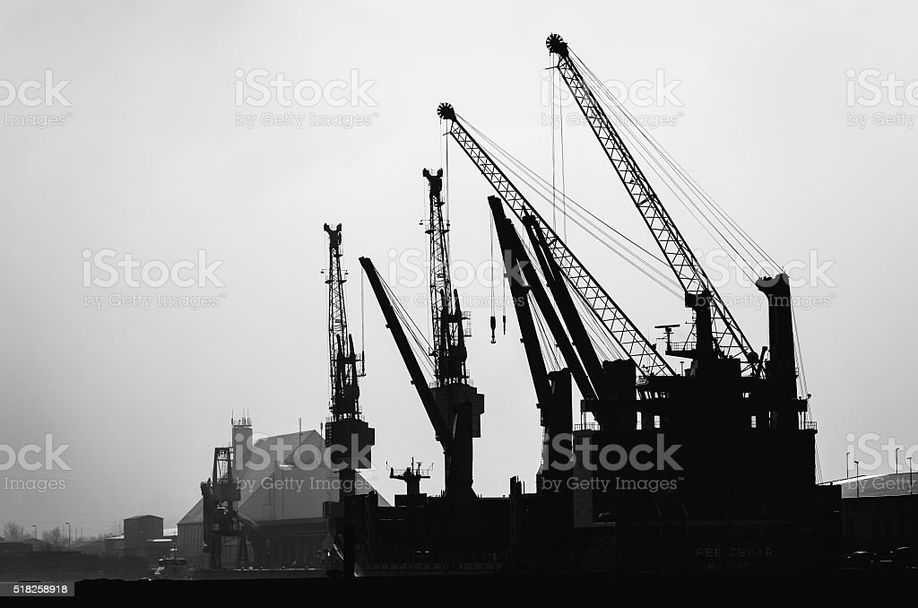 Cranes at the harbor of Hamburg in Germany stock photo