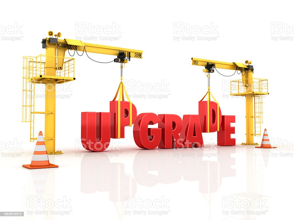 Cranes building the UPGRADE Word stock photo