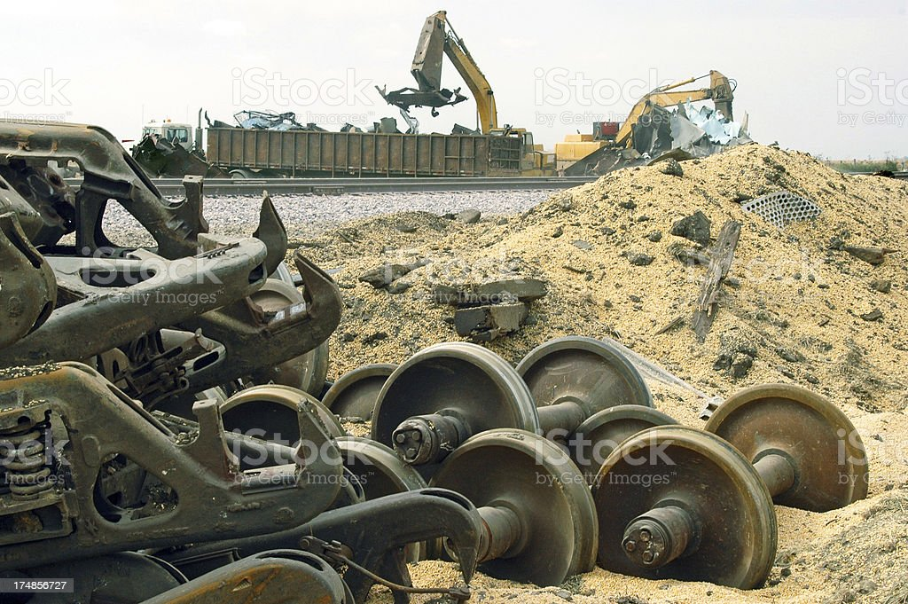 Cranes cleaning up ruined boxcars after train derailment in Iowa royalty-free stock photo