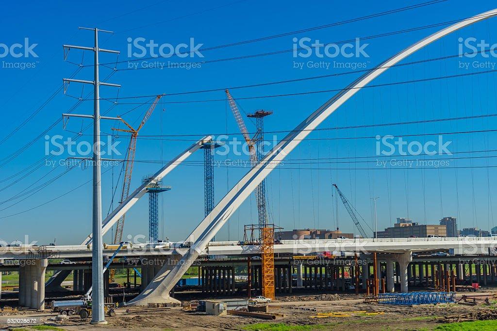 Cranes constructing freeway bridge, Dallas Texas (P) stock photo