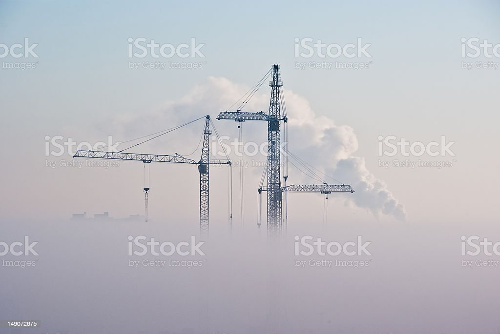 Cranes in clouds stock photo