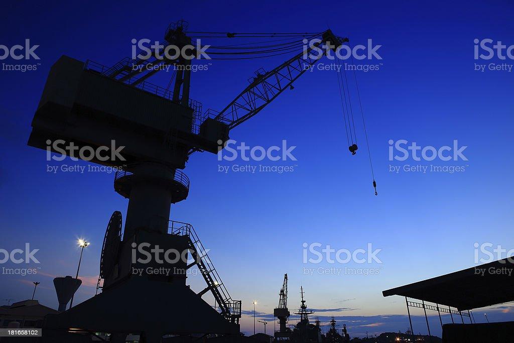 Cranes in dockyard  at sunset royalty-free stock photo