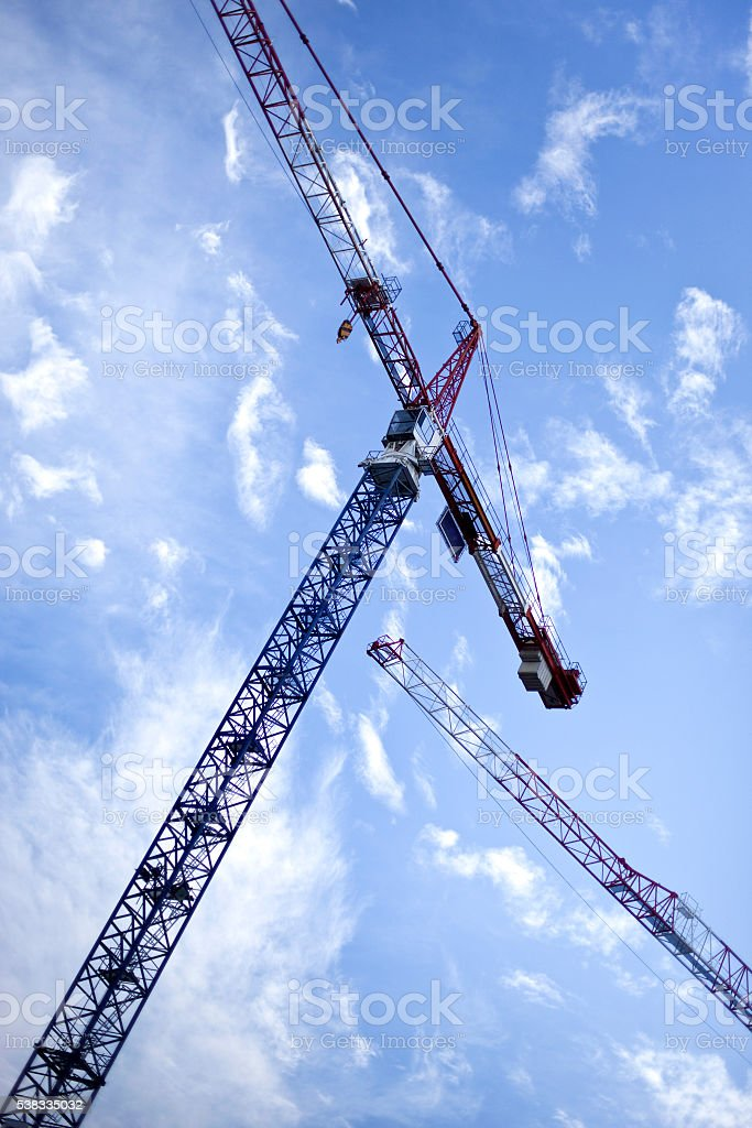 Cranes on a blue sky background stock photo