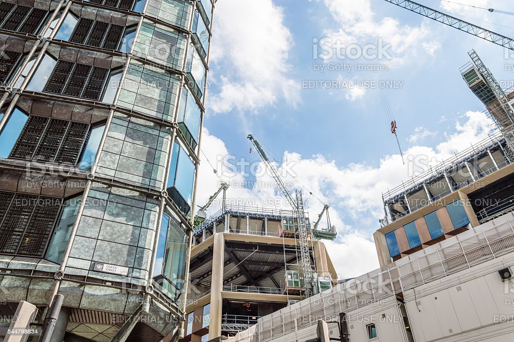 Cranes on a building under construction stock photo