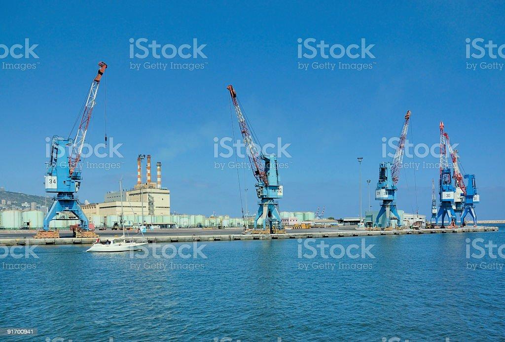 cranes on a cargo pier royalty-free stock photo