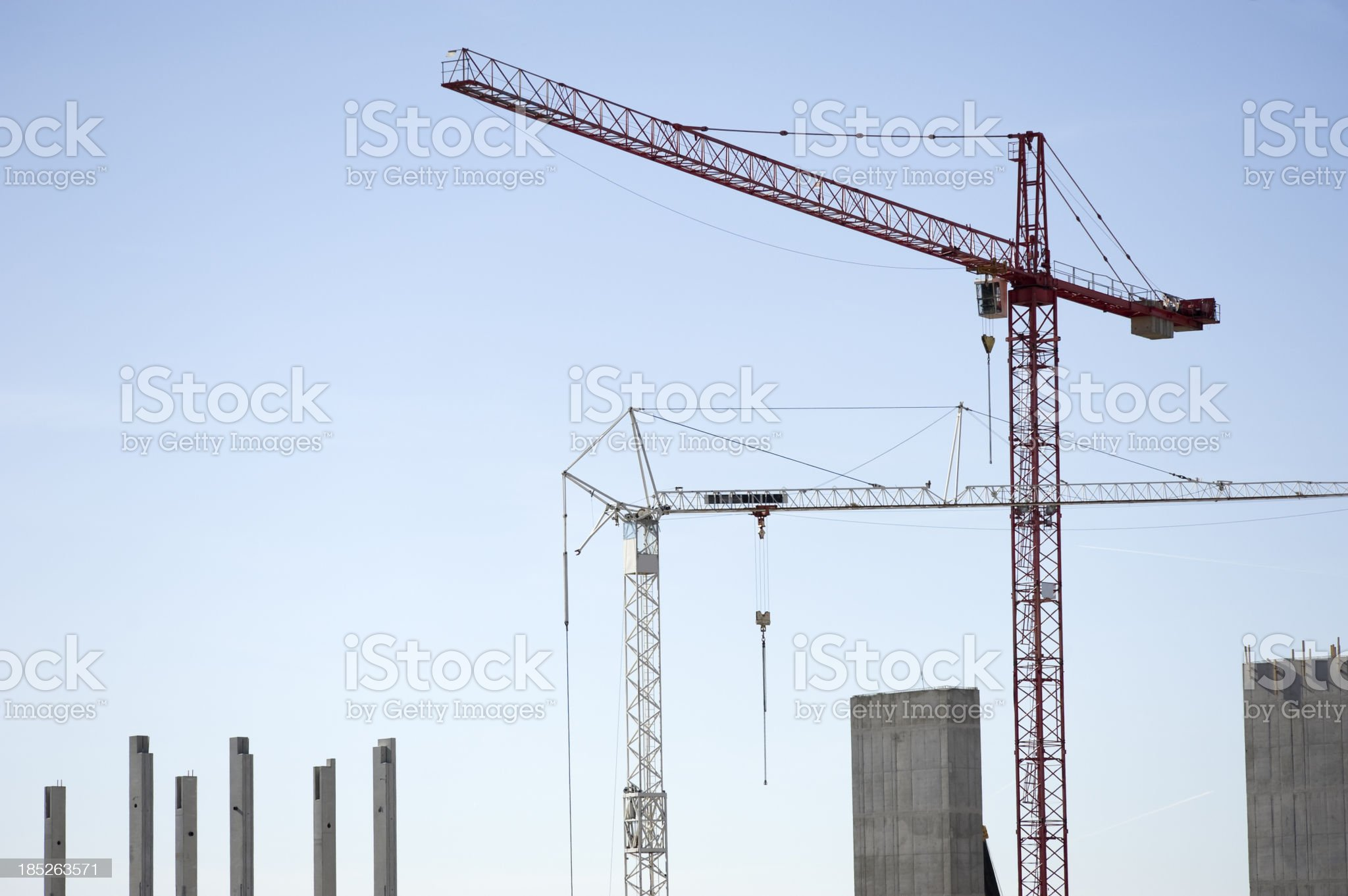 Cranes on a construction site royalty-free stock photo