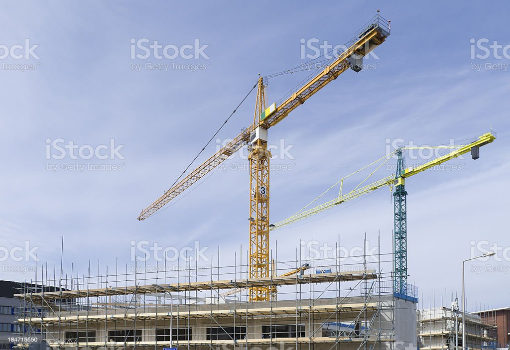 cranes on construction site royalty-free stock photo