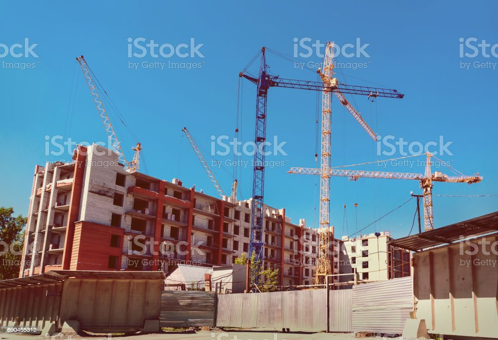 cranes under a blue sky stock photo