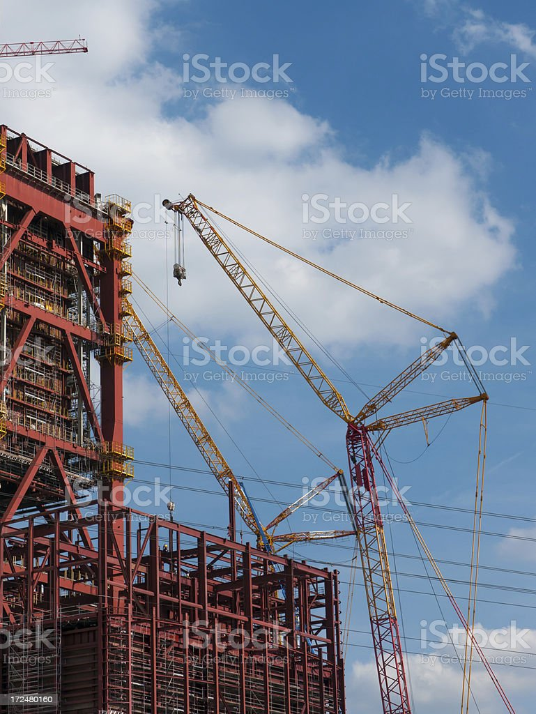 Cranes working on steel construction royalty-free stock photo
