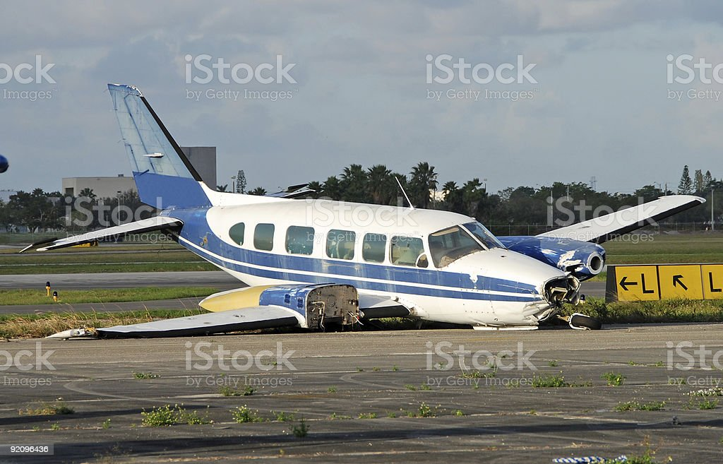 Crash landed propeller airplane stock photo