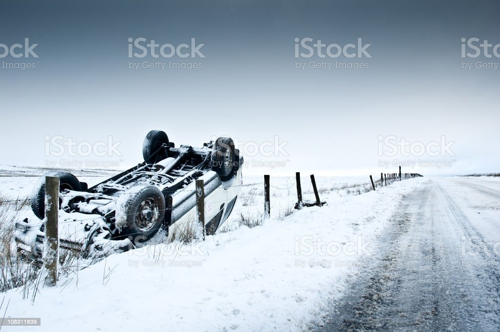 Crashed 4X4 Covered In Snow stock photo