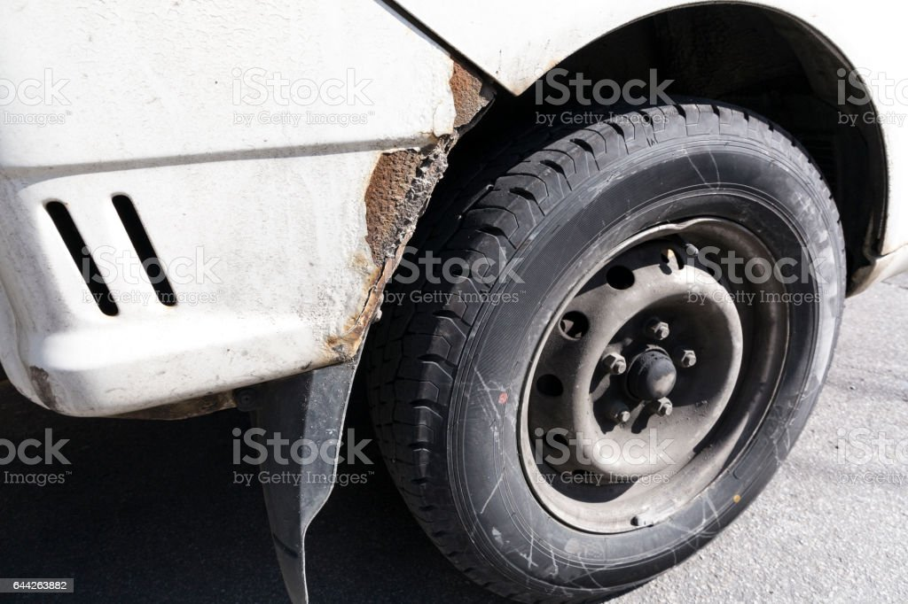 crashed car front side and bumper tire stock photo