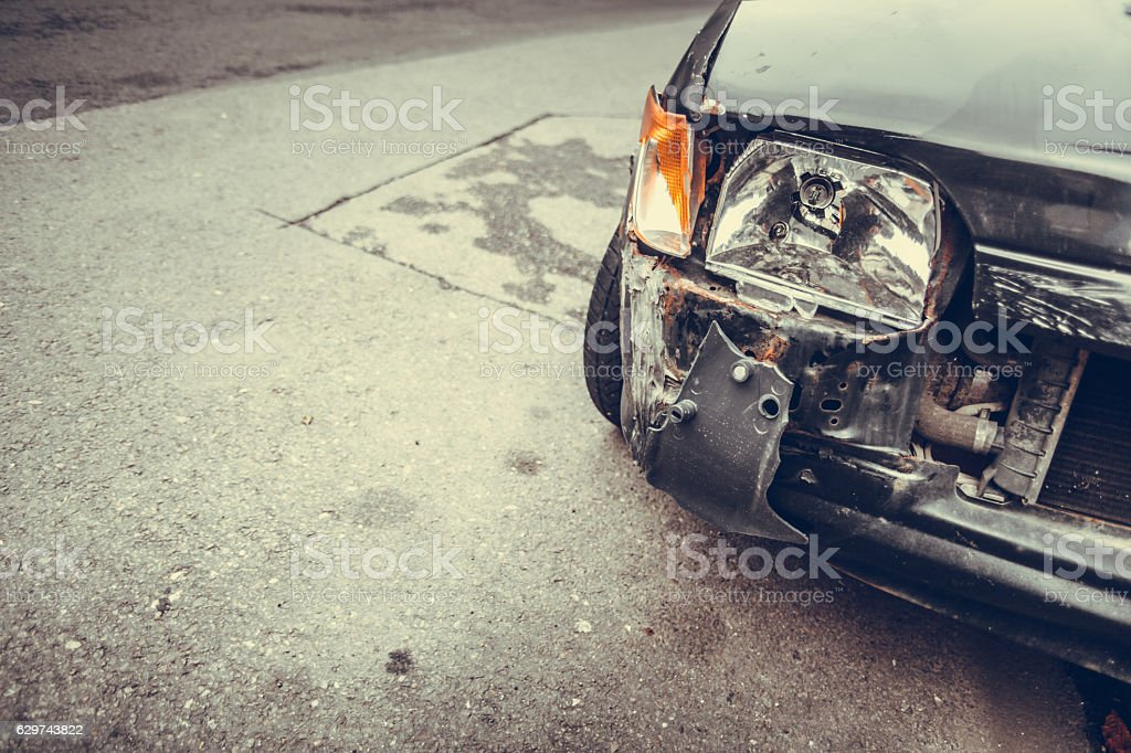 Crashed car headlight detail stock photo