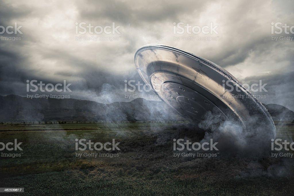 UFO crashing on a crop field stock photo